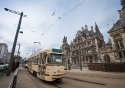 A traditional tram stopping outside the National Bank in Antwerp, Belgium
