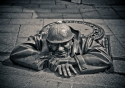 The bronze Peeper hidden in the streets of Bratislava, Slovakia