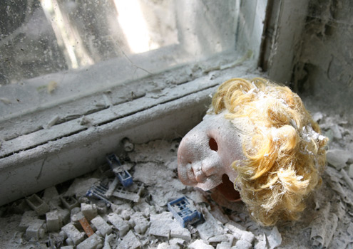 An eerie doll's head languishes on the kindergarten window sill in Pripyat