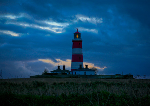 Sleepy Happisburgh lighthouse on the north norfolk coast