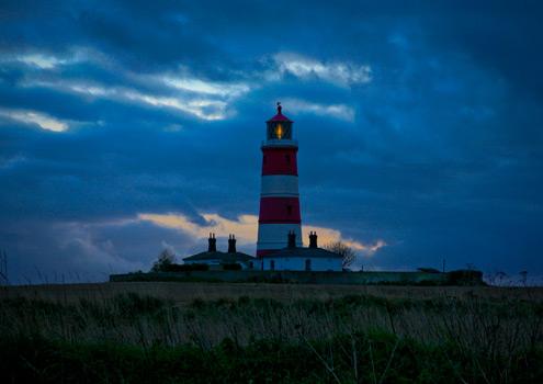 Sleepy Happisburgh lighthouse on the north norfolk coast